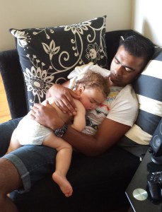 My sick bubba sleeping in Daddy's arms